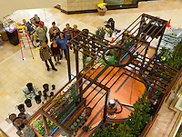 "A long-exposure image showing Orange Coast College's Ornamental Horticulture Club standing in front of their in-progress installation at the 2012 South Coast Plaza Spring Garden Show in Costa Mesa, CA.  People standing in the picture are: Paul Martin, Nancy Brown, Janis Hunter, Ute Smith, Terrel Cook, Gwen Stacy, Meredith Obler.  Sitting in back Debbie Coultas and an unidentified man. The theme for this year's show is ""healing gardens"", and the OCC team is installing a ""garden for the blind,"" which will be complete with a braille world globe and braille labels.  This picture was taken Tuesday April 25, 2012 at ~11pm, as the team was working to meet their Thursday-morning deadline."