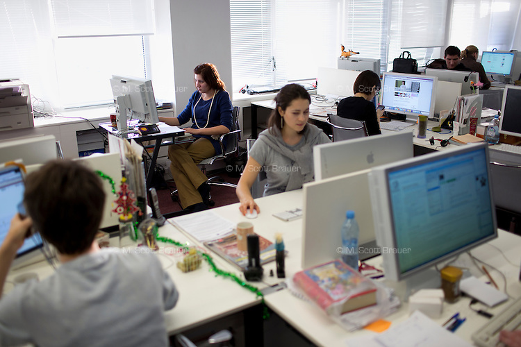 Reporters and editors work in the editorial offices of Russia Beyond the Headlines in Moscow, Russia.  Russia Beyond the Headlines is a publication produced by Rossiskaya Gazeta and the Russian government to produce foreign language news about Russia.  The publications, which feel and look like newspapers, are distributed as paid advertising inserts in major publications throughout the world.
