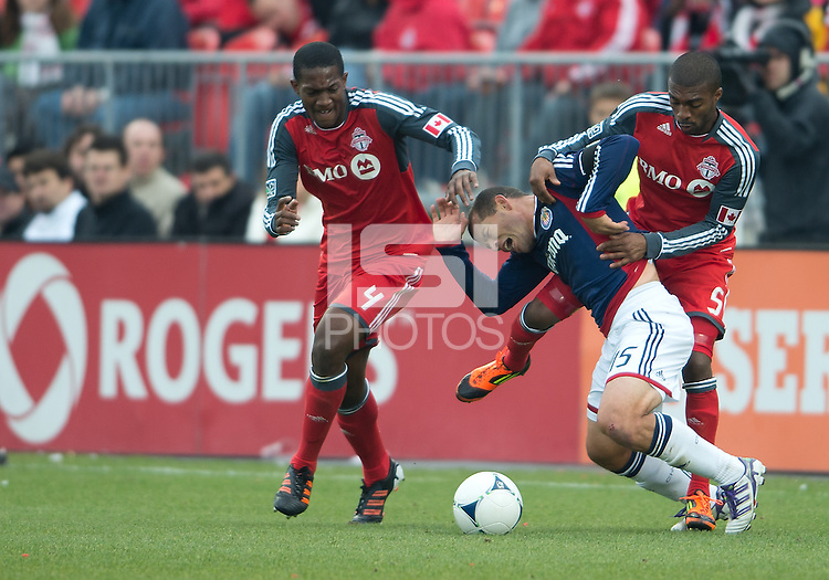 14 April 2012: Chivas USA forward Alejandro Moreno #15 battles with Toronto FC defender Ashtone Morgan #5 and Toronto FC defender Doneil Henry #4 during the second half in a game between Chivas USA and Toronto FC at BMO Field in Toronto..Chivas USA won 1-0.