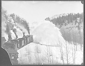 Rotary snowplow OM clearing snow with four light engines.<br /> D&amp;RGW  Cumbres Pass, CO  Taken by Ballough, Monte