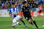 Unai Bustinza of Club Deportivo Leganes competes for the ball with Marco Asensio of Real Madrid during the match of  La Liga between Club Deportivo Leganes and Real Madrid at Butarque Stadium  in Leganes, Spain. April 05, 2017. (ALTERPHOTOS / Rodrigo Jimenez)