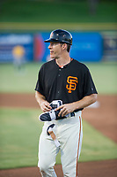 AZL Giants first base coach Bill Horton (14) during the game against the AZL Athletics on August 5, 2017 at Scottsdale Stadium in Scottsdale, Arizona. AZL Athletics defeated the AZL Giants 2-1. (Zachary Lucy/Four Seam Images)