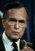 ***FILE PHOTO*** George H.W. Bush Has Passed Away<br /> Washington DC, USA, 1989<br /> President George H.W. Bush answers reporters questions during a short news conference in the press briefing room of the White  House <br /> CAP/MPI/MRN<br /> &copy;MRN/MPI/Capital Pictures