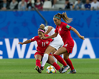 GRENOBLE, FRANCE - JUNE 15: Rosie White #13 of the New Zealand National Team fails to penetrate defenders Desiree Scott #11 of the Canadian National Team and Shelina Zadorsky #4 of the Canadian National Team during a game between New Zealand and Canada at Stade des Alpes on June 15, 2019 in Grenoble, France.
