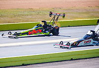 Oct 15, 2017; Ennis, TX, USA; NHRA top fuel driver Richie Crampton (left) races alongside Steve Torrence (as he blows a tire and crashes his dragster as he wins in the second round of the Fall Nationals at the Texas Motorplex. Torrence walked away from the crash. Mandatory Credit: Mark J. Rebilas-USA TODAY Sports