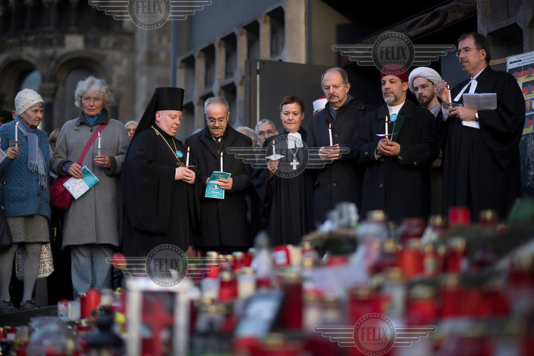 Ulrike Trautwein, Bernd Streich, Mohamed Taha Sabri, Martin Germer, represent various faiths, during a peace rally with the slogan 'Religionen fuer ein weltoffenes Berlin' (Religions for a an open Berlin). It was held in memory of the victims of the Breitscheidtplatz Christmas market terror attack.