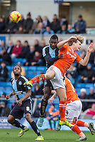 Aaron Pierre of Wycombe Wanderers Craig Mackail-Smith of Luton Town battles for the ball during the Sky Bet League 2 match between Wycombe Wanderers and Luton Town at Adams Park, High Wycombe, England on 6 February 2016. Photo by Andy Rowland.