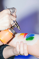 A woman gets a temporary airbrush tattoo of the NBC logo at the MSNBC After Party at the United States Institute of Peace in Washington, DC. The party followed the annual White House Correspondents Association Dinner on Saturday, April 30, 2016. The party continued until about 3 AM on Sunday, May 1, 2016.