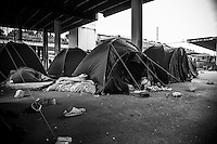 Tents recently set up by MEDU (Medici per i Diritti Umani) near the track n.15 at Ostiense station. Despite the police authorities  attempts of evictions, a temporary agreement with the FS (Ferrovie dello Stato - Public railways company) has been found to occupy the railway property soil.