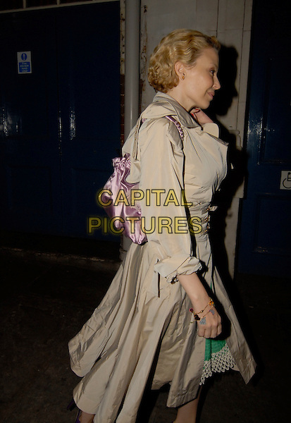 KYLIE MINOGUE.Leaving J Sheekey's restaurant, London, England,.March 31st 2007..half length beige belted waist mac trench coat purple bag profile.CAP/SW.©Stephen Walters/Capital Pictures.