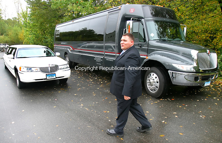 WATERBURY, CT. 14  October  2005-101405SV02--Joe Mauriello, operations manager, of Gateway Limousine Inc., walks past the companies new large limo in Waterbury Friday.<br /> Steven Valenti / Republican-American<br /> (Joe Mauriello, (cq))