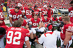 Wisconsin Badgers assistant coach Charlie Partridge talks to the defensive lineman during an NCAA college football game against the San Jose State Spartans on September 11, 2010 at Camp Randall Stadium in Madison, Wisconsin. The Badgers beat San Jose State 27-14. (Photo by David Stluka)