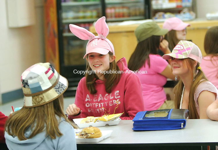 WOODBURY, CT 4/10/07- 041007BZ01- From left- Seventh graders Jillian Gabris, 12, (back to camera), Lauren Zabit, 12, and Becky Yesulaites, 13, showed their spirit by wearing hats and sandals to school during Spirit Week at Woodbury Middle School Tuesday.  <br /> Jamison C. Bazinet Republican-American