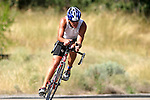 A triathlete leans into a corner during a national qualifying triathlon in Lake Chelan in July, 2007