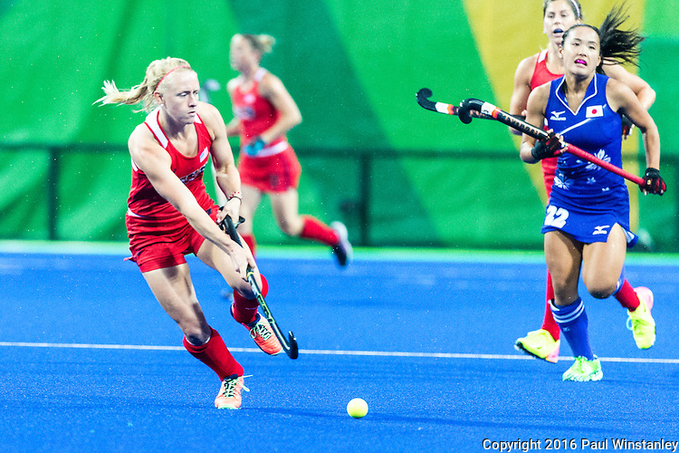 Jill Witmer #10 of United States passes the ball while Motomi Kawamura #22 of Japan tries to catch up during USA vs Japan in a Pool B game at the Rio 2016 Olympics at the Olympic Hockey Centre in Rio de Janeiro, Brazil.