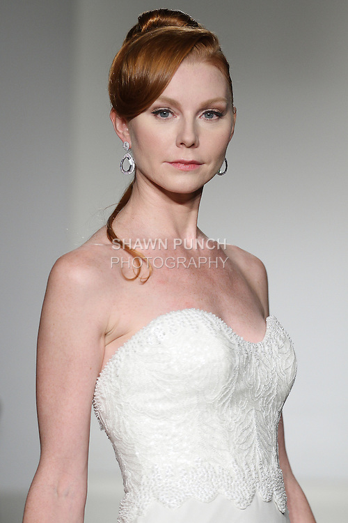 "Model walks runway in a bridal gown from the Matthew Christopher 2015 ""A Reflection of Inspiration"" bridal collection, by Matthew Chrisopher Sobanski, during New York Bridal Market Week Spring 2015."