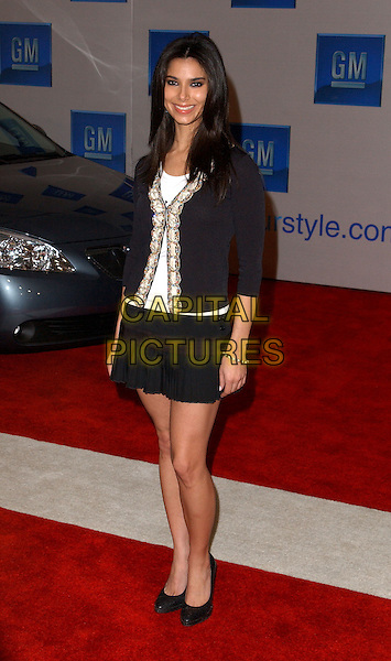 """ROSELYN SANCHEZ.3rd Annual GM """"Ten"""" fashion show and charity event to celebrate award season and car culture held at Sunset and Vine in the heart of Hollywood .24 February 2004                                                                  *UK Sales Only*                                                             .full length, full-length, black miniskirt, cardigan, shoes, heels.www.capitalpictures.com.sales@capitalpictures.com.©Capital Pictures."""