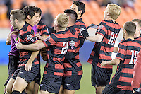 Houston, TX - Friday December 9, 2016: The Stanford Cardinal celebrate after beating the North Carolina Tar Heels in an overtime shootout at the NCAA Men's Soccer Semifinals at BBVA Compass Stadium in Houston Texas.