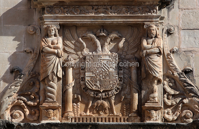 Ornamented Coat of Arms of Charles I of Spain (Charles V), portal of the Royal Schools, 16th century, Tortosa, Tarragona, Spain. Founded by Charles V for the purpose of educating the Moors, the Royal Schools are some of the best examples of Renaissance civil architecture in Catalonia. Picture by Manuel Cohen