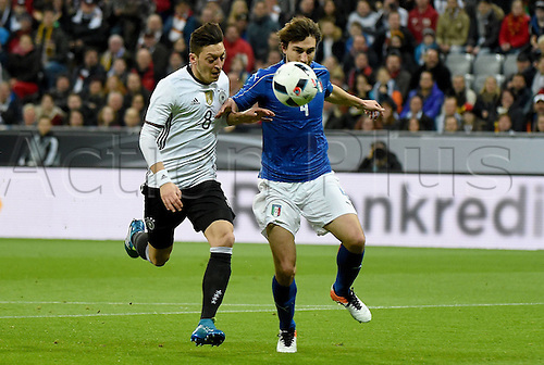 29.03.2016. Munich, Germany. International soccer match between Germany and Italy, at the Allianz Arena in Munich. Mesut Oezil (ger), Thiago Motta (Ita)