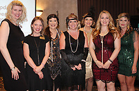 NWA Democrat-Gazette/CARIN SCHOPPMEYER Tiffany Hellerstedt (from left),  Heather Fox, Jennifer Scott Heiges, Cristina Easterling,  Erica Bell, Beth Emmanuel and Melissa Santos, Junior League board members welcome League members to the Roaring's '20s Party.