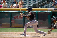 Juan Ciriaco (13) of the Fresno Grizzlies at bat against the Salt Lake Bees at Smith's Ballpark on May 26, 2014 in Salt Lake City, Utah.  (Stephen Smith/Four Seam Images)