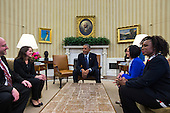 United States President Barack Obama (C) meets with four of the letter writers who will join the First Lady and Dr. Biden as guests of the Administration for tonightís State of the Union Address in the Oval Office of the White House in Washington, DC, USA, 20 January 2015. Obama's State of the Union speech will include a proposal to increase taxes on the wealthy, and a proposal to require employers to provide paid sick leave to their workers.<br /> Credit: Jim LoScalzo / Pool via CNP