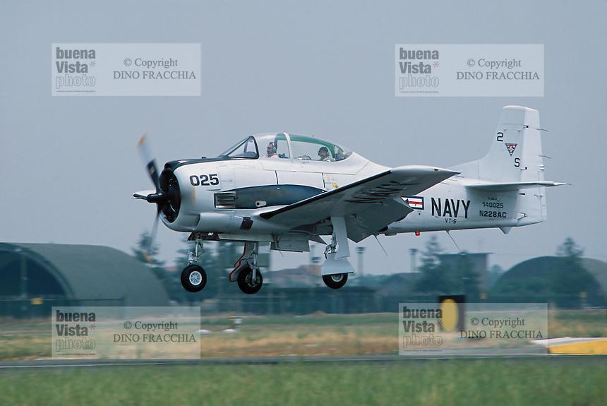 - US Navy training aircraft North American T-28 Trojan during an air show on air force base of Ghedi (Brescia)....- aereo da addestramento North American T-28 Trojan dell'US Navy durante un esibizione sulla base aerea di Ghedi (Brescia)......