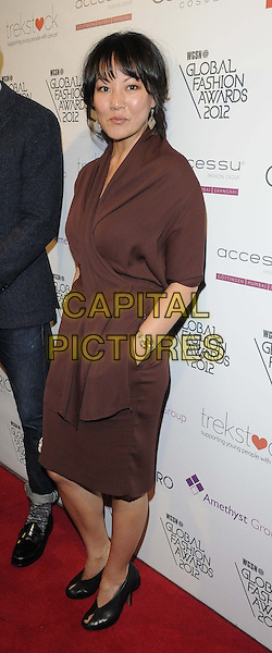 Jewon Yu.The WGSN Global Fashion Awards, Savoy Hotel, The Strand, London, England..November 5th, 2012.full length hand in pocket brown dress .CAP/CAN.©Can Nguyen/Capital Pictures.