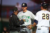 Clinton LumberKings manager Scott Steinmann (22) during a discussion with umpires C.J. Davis, J.C. Velez (hidden) and manager Chad Tracy (28) about a light tower in left field going off during a game against the Burlington Bees on August 20, 2015 at Community Field in Burlington, Iowa.  Burlington defeated Clinton 3-2.  (Mike Janes/Four Seam Images)