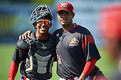 Batavia Muckdogs catcher Pablo Garcia (7) and pitcher Jose Diaz (47) after the first game of a doubleheader against the Auburn Doubledays on September 4, 2016 at Dwyer Stadium in Batavia, New York.  Batavia defeated Auburn 1-0 in a continuation of a game started on August 13. (Mike Janes/Four Seam Images)