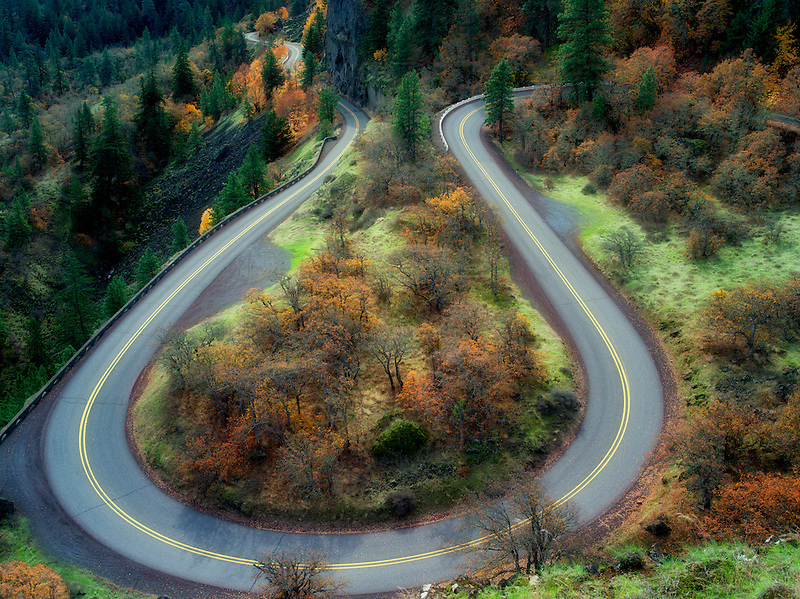 Curving road with fall colors in the Columbia River Gorge National Scenic Area. Oregon