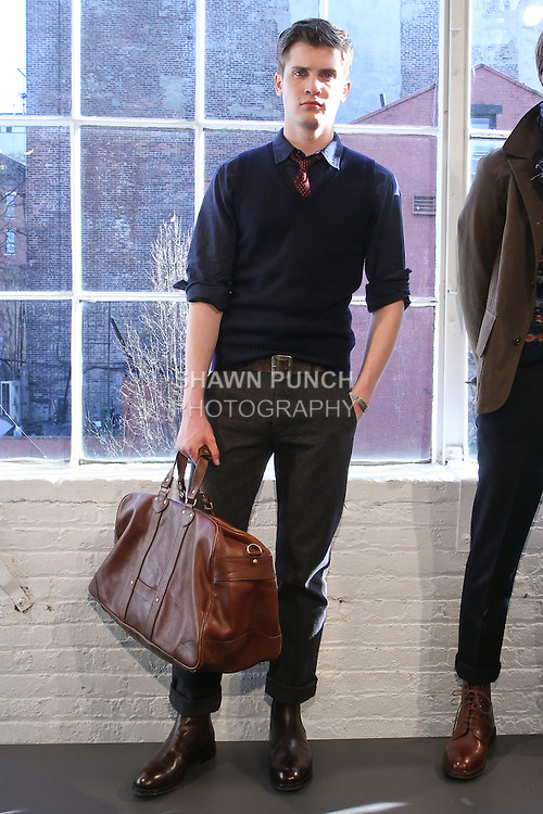 Model poses in an outfit by Frank Muytjens, for the J. Crew Mens Fall 2011 Collection presentation.