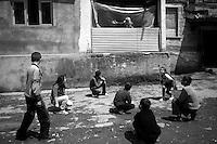 "Nagorny-Karabach, 16.05.2011, Shushi. Ein alte Frau schimpft vom Balkon herunter mit Kindern, die vor ihrer Wohnung spielen.""The Twentieth Spring"" - ein Portrait der s¸dkaukasischen Stadt Schuschi, 20 Jahre nach der Eroberung der Stadt durch armenische K?mpfer 1992 im B¸gerkrieg um die Unabh?ngigkeit Nagorny-Karabachs (1991-1994). An old woman grumble towards some playing kids in Shushi. ..""The Twentieth Spring"" - A portrait of Shushi, a south caucasian town 20 years after its ""Liberation"" by armenian fighters during the civil war for independence of Nagorny-Karabakh (1991-1994). .Une vieille femme se plaint envers certains enfants qui jouent à Chouchi.""Le Vingtieme Anniversaire » - Un portrait de Chouchi, une ville du Caucase du Sud 20 ans après sa «libération» par les combattants arméniens pendant la guerre civile pour l'indépendance du Haut-Karabakh (1991-1994)..© Timo Vogt/Est&Ost, NO MODEL RELEASE !!"