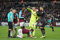 Goalkeeper Adrian of West Ham United protests that Olivier Giroud of Arsenal kick was high to Referee Jonathan Moss during the Premier League match between West Ham United and Arsenal at the Olympic Park, London, England on 13 December 2017. Photo by Andy Rowland.