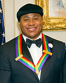 LL COOL J, one of he five recipients of the 40th Annual Kennedy Center Honors with his award as he poses for a group photo following a dinner hosted by United States Secretary of State Rex Tillerson in their honor at the US Department of State in Washington, D.C. on Saturday, December 2, 2017. The 2017 honorees are: American dancer and choreographer Carmen de Lavallade; Cuban American singer-songwriter and actress Gloria Estefan; American hip hop artist and entertainment icon LL COOL J; American television writer and producer Norman Lear; and American musician and record producer Lionel Richie.  <br /> Credit: Ron Sachs / Pool via CNP