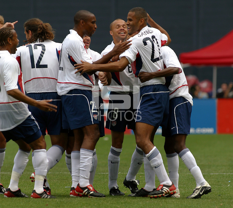 Tony Sanneh, USA team celebrate, Uruguay vs USA, 2002.