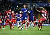 5th December 2017, Stamford Bridge, London, England; UEFA Champions League football, Chelsea versus Atletico Madrid; Gary Cahill, the Chelsea captain being challenged by Stefan Savic and Gabi of Atletico Madrid