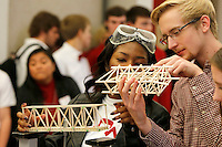 NWA Media/DAVID GOTTSCHALK - 12/12/14 - Chastity Roaf, left, and Michael Allen, both juniors at the University of Arkansas,  prepare bridges for structural testing Friday December 12, 2014 at the Razorback Technology Challenge at the University of Arkansas in Fayetteville. More than 400 students from 28 middle schools, junior high schools and high schools in Arkansas, Oklahoma and Kansas participated and compete in the event that allowed them to show projects they have been working on  in technology and engineering education classes.