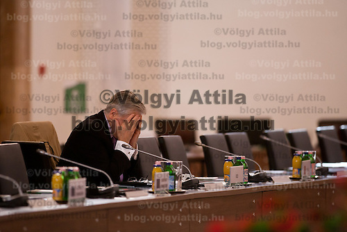 The European Central Bank president Jean-Claude Trichet sits alone when he arrives first at the meeting venue of the informal meeting of European Union (EU) economics and finance ministers in Godollo, a town about 30 km northeast of Budapest, capital of Hungary, on April 9, 2011. The two-day-long informal meeting opened on Friday in Godollo. ATTILA VOLGYI