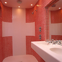 The mosaic tiles in the wet room were picked up from bankrupt stock and the red and white colour creates a warm atmosphere