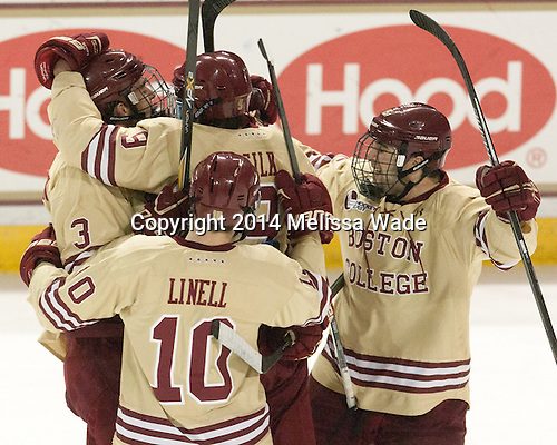 Ian McCoshen (BC - 3), Danny Linell (BC - 10), Brendan Silk (BC - 9), Cam Spiro (BC - 15) - The Boston College Eagles defeated the visiting University of Michigan Wolverines 5-1 (EN) on Saturday, December 13, 2014, at Kelley Rink in Conte Forum in Chestnut Hill, Massachusetts.