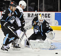 Milwaukee Admirals goaltender Magnus Hellberg watches the puck during the second period of an AHL hockey game against the San Antonio Rampage, Thursday, Jan. 16, 2014, in San Antonio (Darren Abate/AHL)