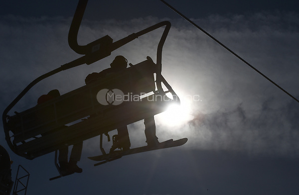 Athletes sitting on a lift in the Olympic Snowboard Phoenix Snow Park in Pyeongchang, South Korea, 07 February 2018. The Pyeongchang 2018 Winter Olympics take place between 09 and 25 February. Photo: Angelika Warmuth/dpa /MediaPunch ***FOR USA ONLY***