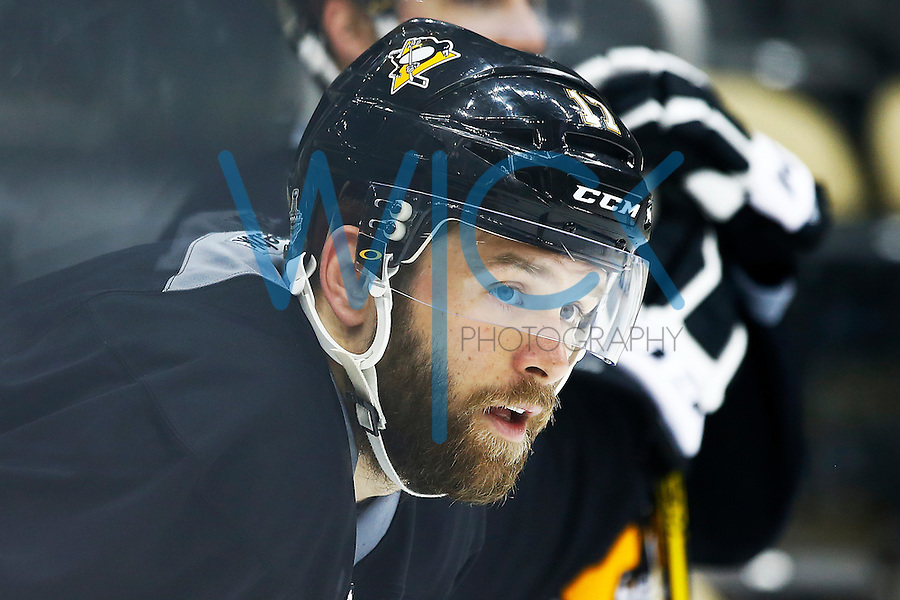 Bryan Rust #17 of the Pittsburgh Penguins looks on during practice prior to the start of the Stanley Cup Final series between the Pittsburgh Penguins and the San Jose Sharks at Consol Energy Center in Pittsburgh, Pennslyvania on May 29, 2016. (Photo by Jared Wickerham / DKPS)