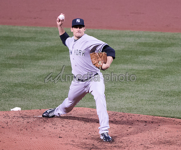 New York Yankees starting pitcher Nathan Eovaldi (30) pitches in the second inning against the Baltimore Orioles at Oriole Park at Camden Yards in Baltimore, MD on Wednesday, April 15, 2015. Photo Credit: Ron Sachs/CNP/AdMedia