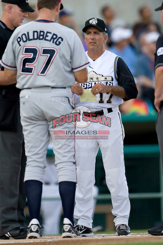 San Antonio Missions manager Doug Dascenzo #17 delivers the lineup card before the Texas League All Star Game played on June 29, 2011 at Nelson Wolff Stadium in San Antonio, Texas. The South All Star team defeated the North All Star team 3-2. (Andrew Woolley / Four Seam Images)