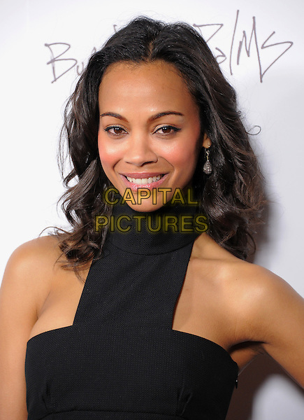 "ZOE SALDANA.attending the New Films Cinema's Premiere of ""Burning Palms"" held at The Arclight Theatre in Hollywood, California, USA, January 12th 2011..portrait headshot  black polo neck cut out smiling beauty make-up rosy cheeks blusher .CAP/RKE/DVS.©DVS/RockinExposures/Capital Pictures."
