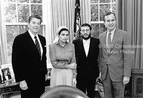 United States President Ronald Reagan, left, and US Vice President George H.W. Bush, right, welcome Mrs. Anatoly Shcharansky (Avital), center left, wife of jailed Soviet dissident Anatoly Shcharansky , and recently released Soviet dissident Iosif Mendelevich, center right, to the Oval Office of the White House in Washington, DC on May 28, 1981.  The President promised Mrs. Shcharansky he would do all he could to help secure her husband's release as well as all of the others who are persecuted in the Soviet Union.<br /> Mandatory Credit: Bill Fitz-Patrick / White House via CNP