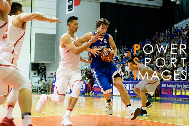 Duncan Reid of Hong Kong (R) in action against Jianlian Yi of China (L) during the FIBA Basketball World Cup 2019 Asian Qualifier Group A match between Hong Kong and China at Southorn Stadium on February 26, 2018 in Hong Kong. Photo by Marcio Rodrigo Machado / Power Sport Images